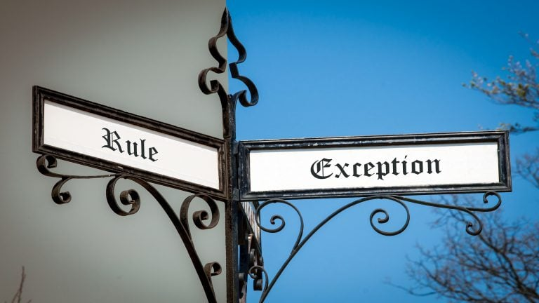 "A street signpost -- one direction ""rule,"" the other ""exception"""